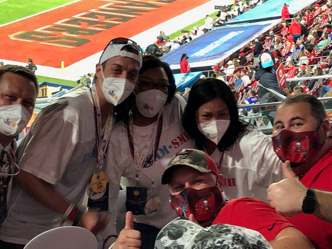 Members of the patient care team from 5 Waldemere Tower at Sarasota Memorial Hospital attend Super Bowl LV in Tampa.