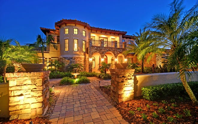 This French-style chateau estate in Lakewood Ranch's Lake Club community includes four bedrooms, five-and-a-half bathrooms, and two islands in the gourmet kitchen.