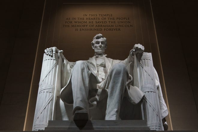 The statue of President Abraham Lincoln is seen at the Lincoln Memorial, Friday, Nov. 6, 2020, in Washington. On Feb. 11, 1861, Lincoln left Springfield for Washington and his inauguration.
