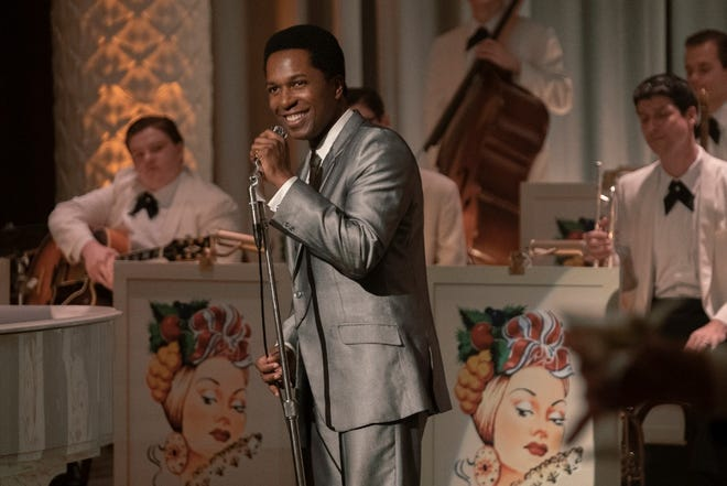 """This image released by Amazon Studios shows Leslie Odom Jr. in a scene from """"One Night in Miami."""" Odom was nominated for a Golden Globe for best supporting actor in a motion picture on Wednesday, Feb. 3, 2021 for his role in the film."""