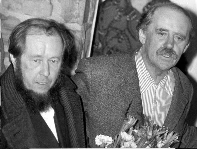 This Feb. 13, 1974, picture shows Russian author and dissident Alexander Solzhenitsyn, left, when he arrived at the house of German author Heinrich Boell in Langenbroich, Germany, after being expelled from the Soviet Union. Solzhenitsyn, the Nobel Prize-winning Russian author whose books chronicled the horrors of dictator Josef Stalin's slave labor camps, died of heart failure in 2008. He was 89.
