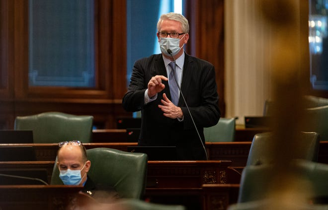 Illinois House Republican Leader Jim Durkin, R-Western Springs, implores members of the Illinois House of Representatives to vote in person for the roll call during session on the floor at the Illinois State Capitol in Springfield, Ill., Wednesday, February 10, 2021. [POOL/Justin L. Fowler/The State Journal-Register]