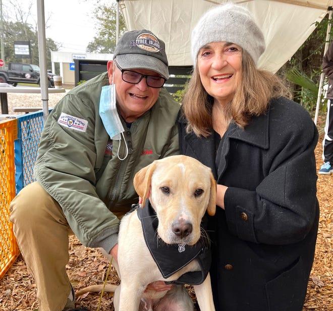 Rick Armstrong, Bentley the Dog and Carol Armstrong.