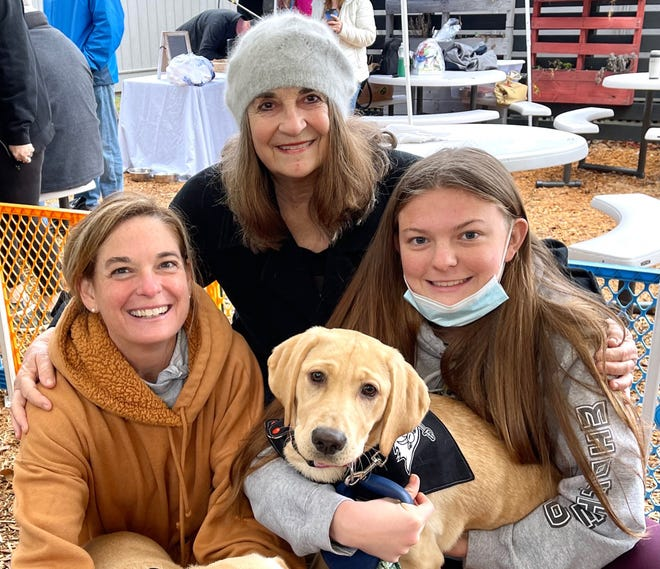 Dutchen Baker, Carol Armstrong, Dixie the Lab, Lauren Baker.