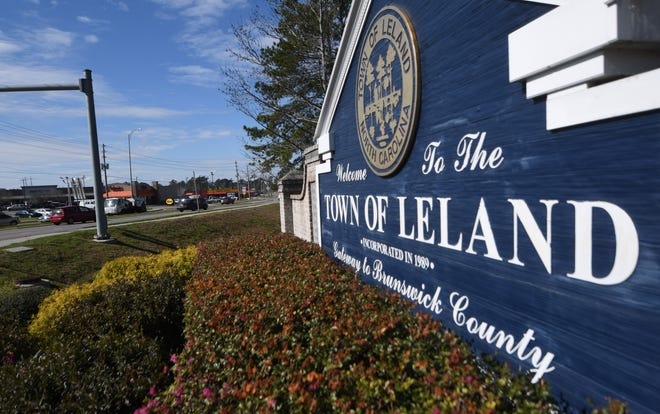 A sign greets people to Leland along Village Rd. in Leland N.C. The area is in the process of creating a long-term growth plan.