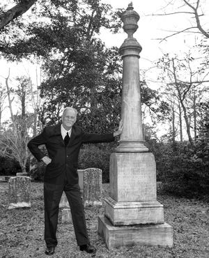 """""""Curious Tales from Old Wilmington and the Lower Cape Fear: The Truth Behind the Legends"""" is the new book from retired UNCW history professor Chris Fonvielle Jr. The author is seen here at Wilmington's Oakdale Cemetery by the monument to William Ellerbrock and his bog, Boss (""""Faithful Unto Death"""")."""