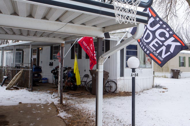 Signs and flags containing vulgar language like this flag in front of Brian Keller's home in southwest Topeka do not violate the City of Topeka's sign code, city officials say.