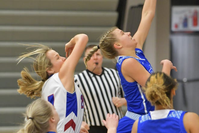 Washburn Rural's Emma Krueger drives for a layup during Tuesday's game at Seaman. Krueger sparks the Junior Blues to a 50-31 win, scoring 18 points.