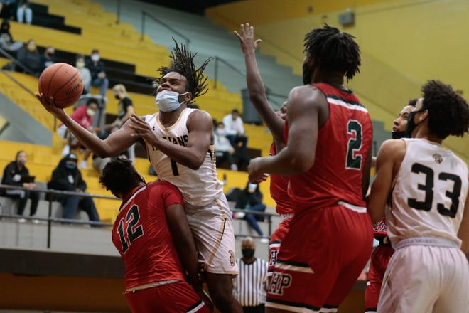 Topeka High senior Jalen Smith (1) scored 27 points, but the Trojans couldn't extend their season, falling 68-57 at Junction City in Saturday's Class 6A sub-state play-in game. High finished the season 3-17.