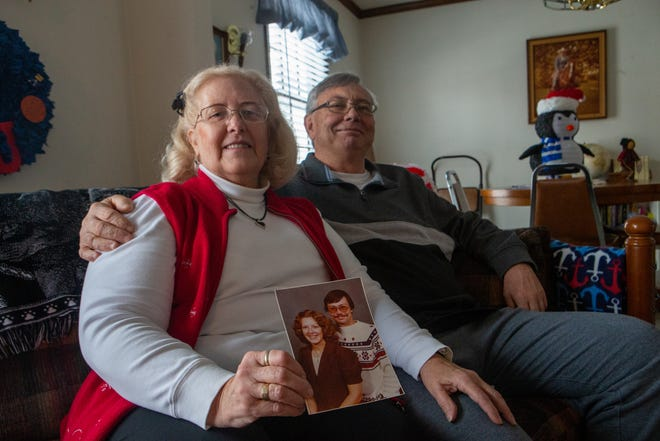 Mickey Shannon holds up a portrait while sitting with husband, Randy, in their Topeka home late last month. Although Randy struggles with dementia, the couple still manages to keep their love alive.
