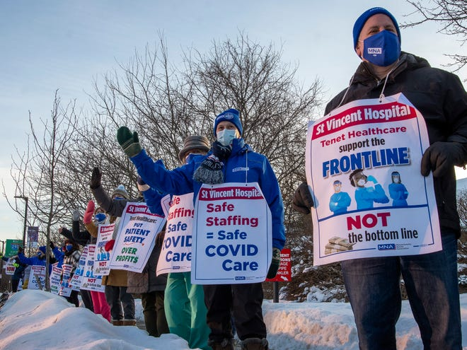 Nurses picket in front of Saint Vincent Hospital on the day that their union is voting on whether to authorize a strike, Feb. 10, 2021.