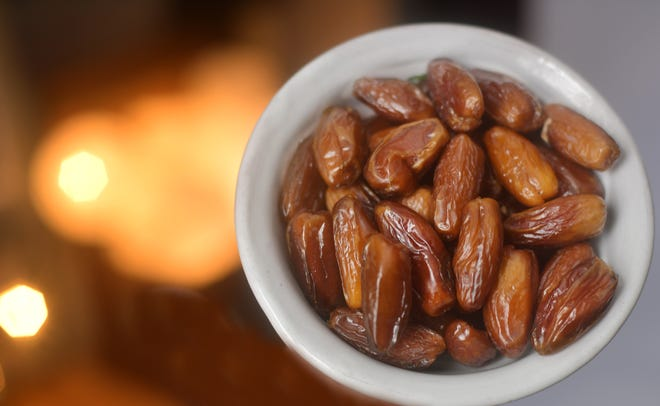 Deglet Noor dates, pictured, are usually smaller, firmer and more delicately flavored than the rich Medjool dates.