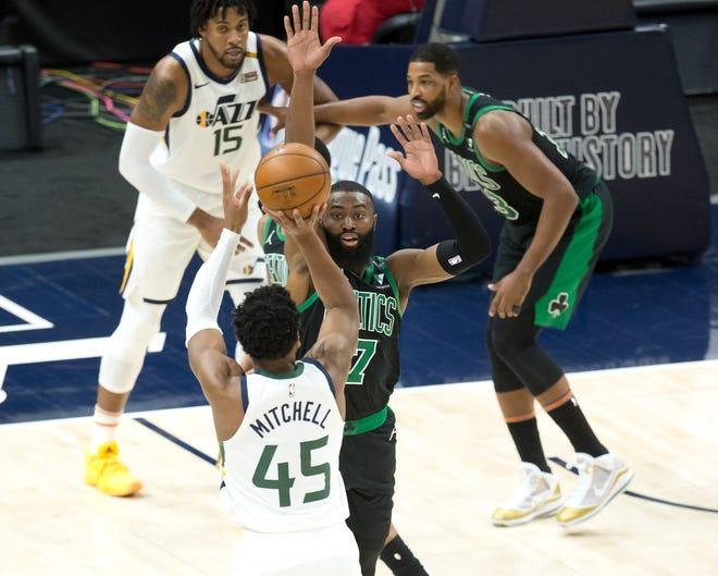 Jazz guard Donovan Mitchell shoots the ball over Celtics forward Jaylen Brown during the first half Tuesday night in Salt Lake City.