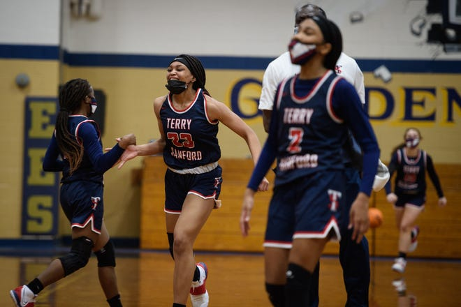 Terry Sanford's Miya Giles-Jones celebrates with teammates after Tuesday's win against E.E. Smith. Giles-Jones played for the Bull-ettes last season.