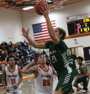 Malvern's Michael Minor drives to the basket as Strasburg's Christian Miller defends Tuesday  night.