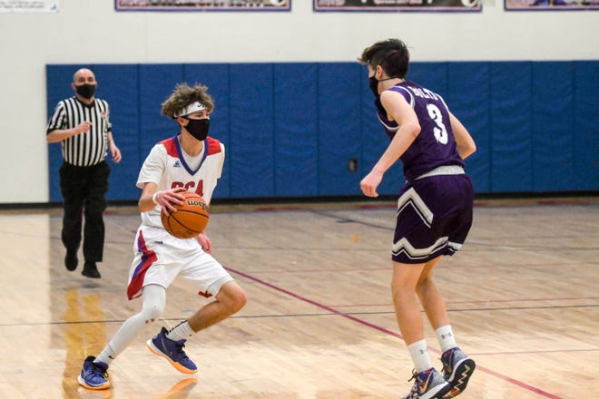 Swallows Charter Academy senior Colby Roberts dribbles against Rye's Jay Graham Tuesday night.