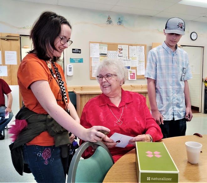 Alaina Shearer, left, and John Nelson, right, deliver Valentine's gifts to Betty Truelove during SRDA's Meals on Wheels Valentine's Day event in 2020.