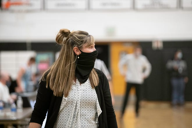 South High School head coach Shannan Lane gives direction from the sideline during the game against Pueblo West on Tuesday February 9, 2021.