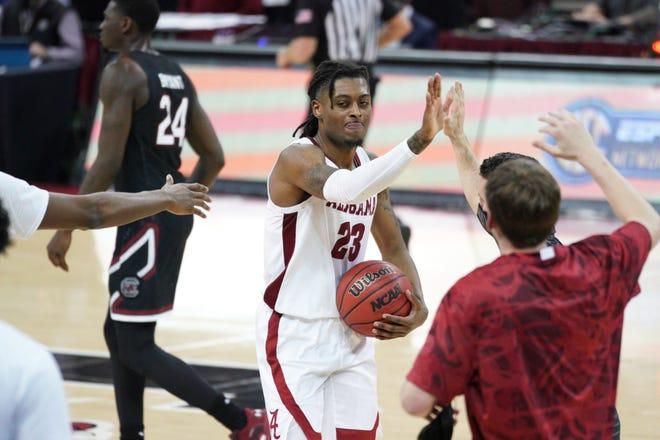 Alabama guard John Petty Jr. (23) celebrates a win with teammates after an NCAA college basketball game against South Carolina Tuesday, Feb. 9, 2021, in Columbia, S.C. Alabama won 81-78. (AP Photo/Sean Rayford)