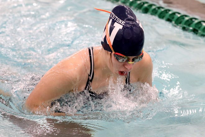 Whetstone's Cristin Flanagan won the girls 100-yard butterfly in the City League meet Feb. 6 at Columbus Aquatics Center. The girls team finished second and the boys squad captured the league championship.