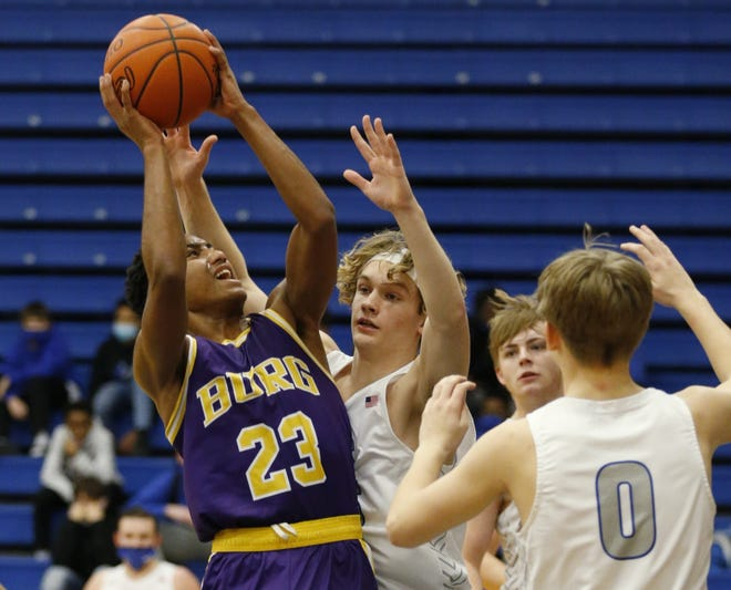 Reynoldsburg's Josiah Mobley goes up for a shot against Central Crossing on Jan. 8. Mobley, who played last season at Whitehall, was averaging 14.5 points through 15 games for the Raiders, who are seeded 10th for the Division I district tournament.