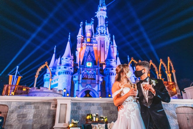 At the stroke of midnight and in true Cinderella style, actor, singer and dancer Jordan Fisher and his childhood sweetheart Ellie Woods proclaimed their love in a private after-hours wedding ceremony in the Walt Disney World Magic Kingdom on Nov 21, 2020.