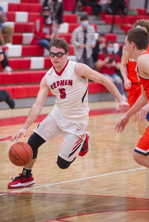 Bucyrus' Mike Wise drives to the basket for the game-winning layup in transition after a steal on the other end.