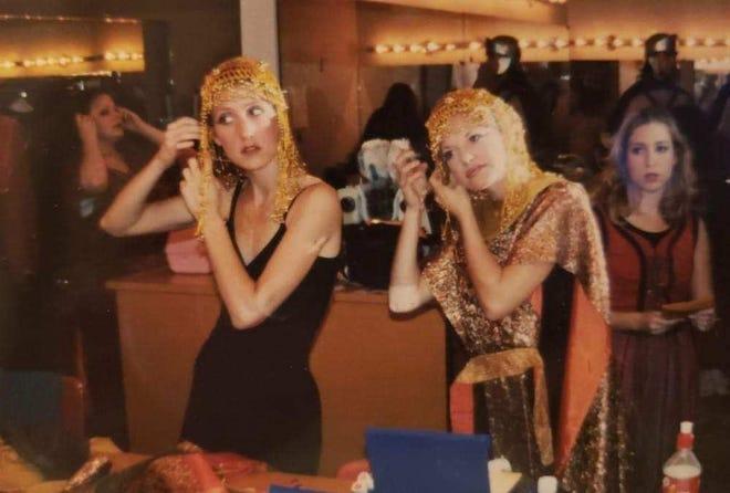 Dancer Jilissa Cotton (left) and Lynn Hartnett prepare for a dance performance in 'Jesus Christ Superstar' in 1997.