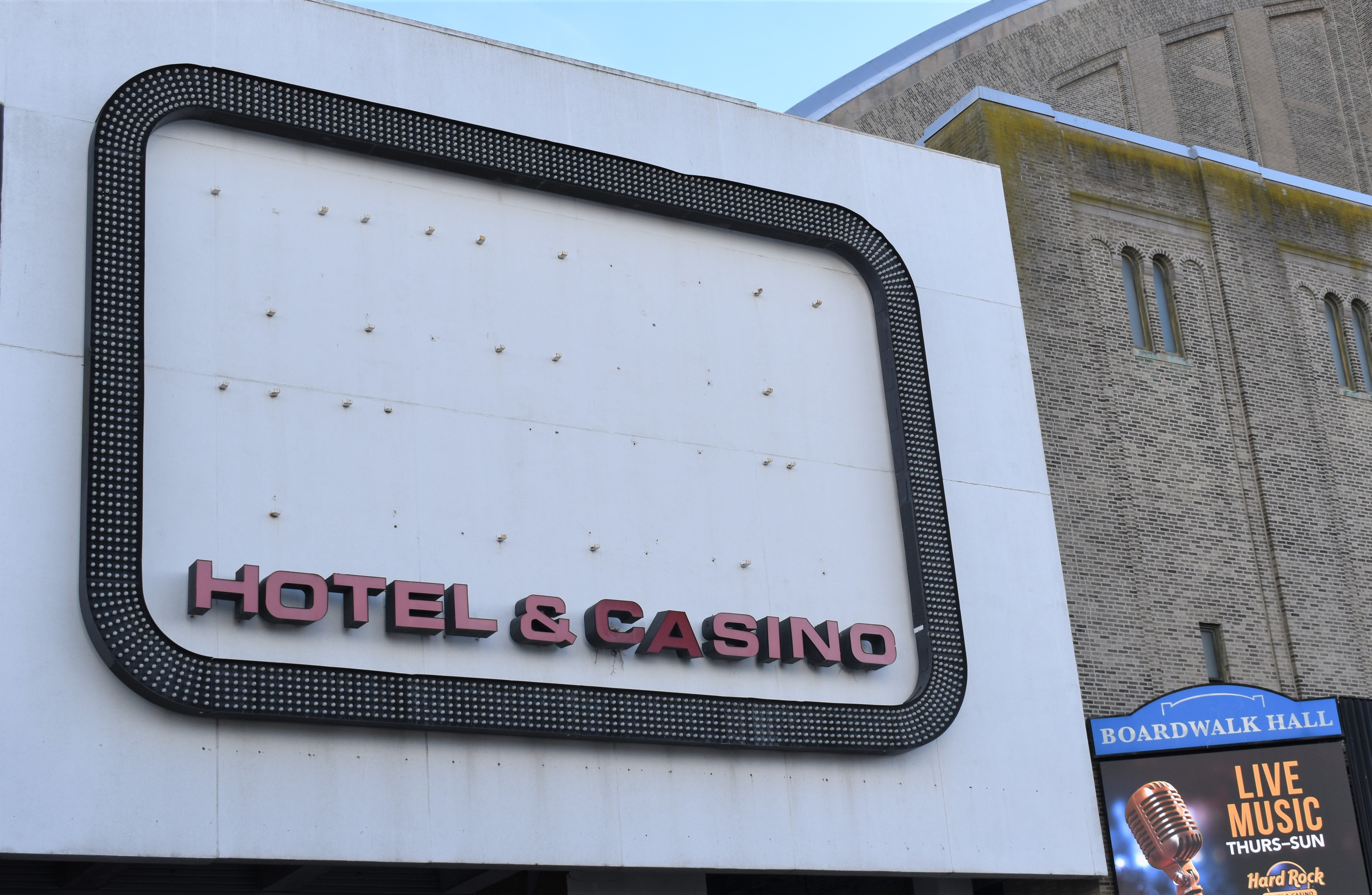 A roadside sign no longer promotes the Trump Plaza casino-hotel, which awaits demolition after closing in 2014.