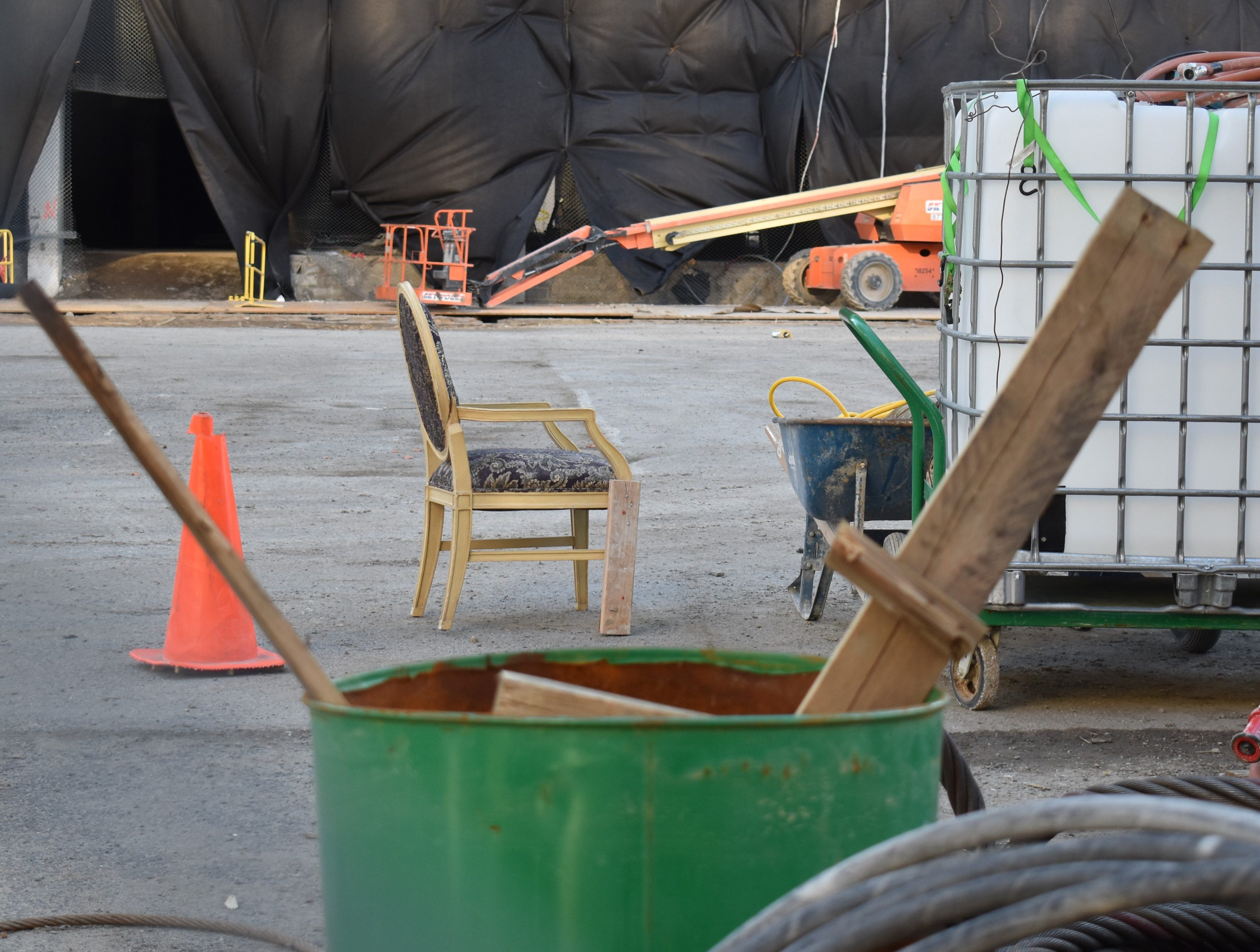 A chair from the long-vacant Trump Plaza, reinforced by a piece of lumber, serves workers preparing to demolish the Atlantic City landmark.