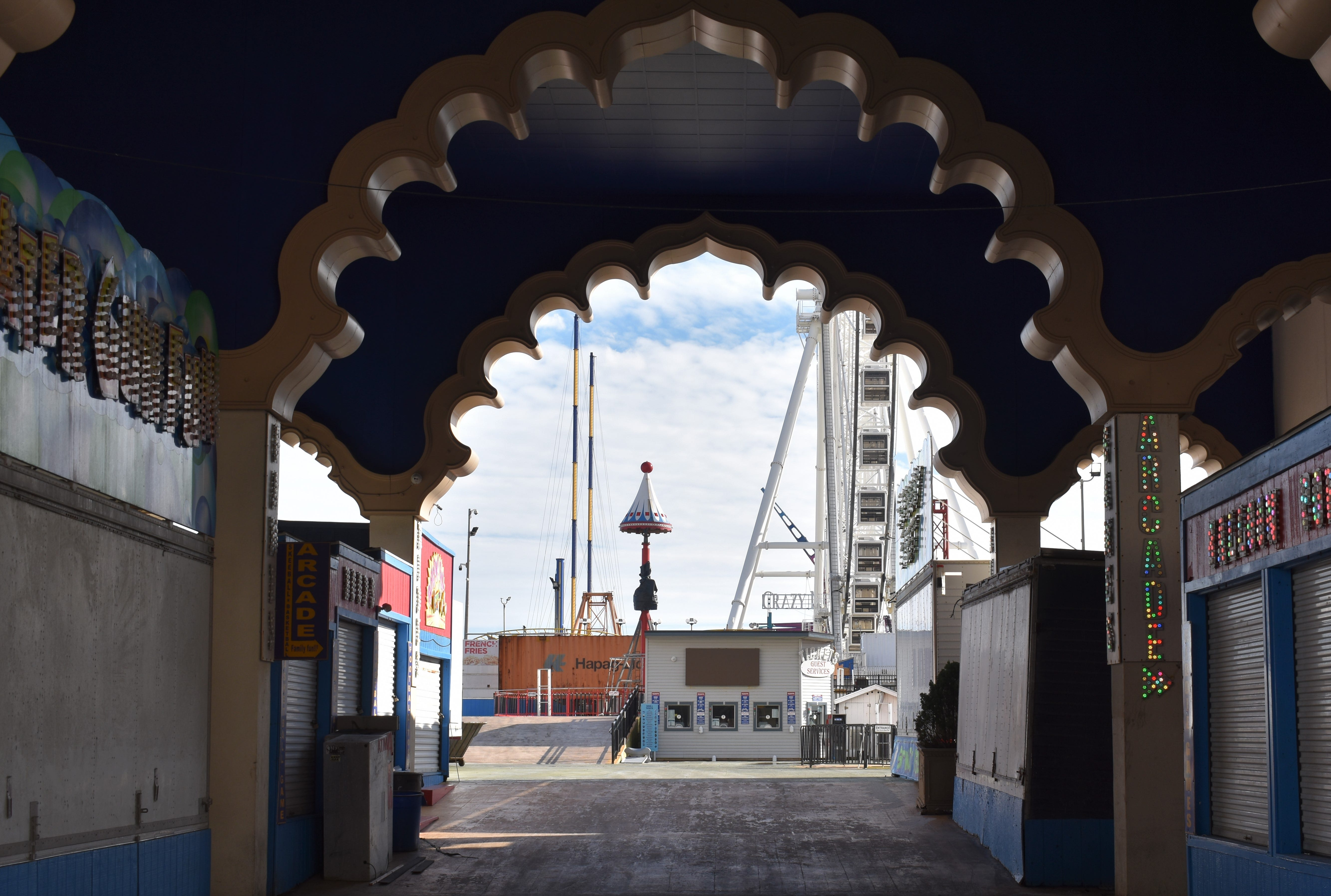 A decorative arch leading to Steel Pier in Atlantic City shows design elements from the former Trump Taj Mahal.