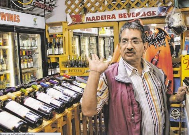 Roop Gupta, photographed inside his store Madeira Beverage following a 2012 robbery during which he was shot and wounded. On Feb. 9, Gupta was fatally shot in an apparent robbery at the store.