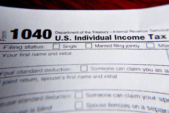 The IRS will accept 2020 income tax returns starting February 12, 2021. FILE - This 2019 photo shows part of a 1040 federal tax form that is reprinted on the Internal Revenue Service website in Zelienople, Pennsylvania.  (AP Photo / Keith Srakocic, file)