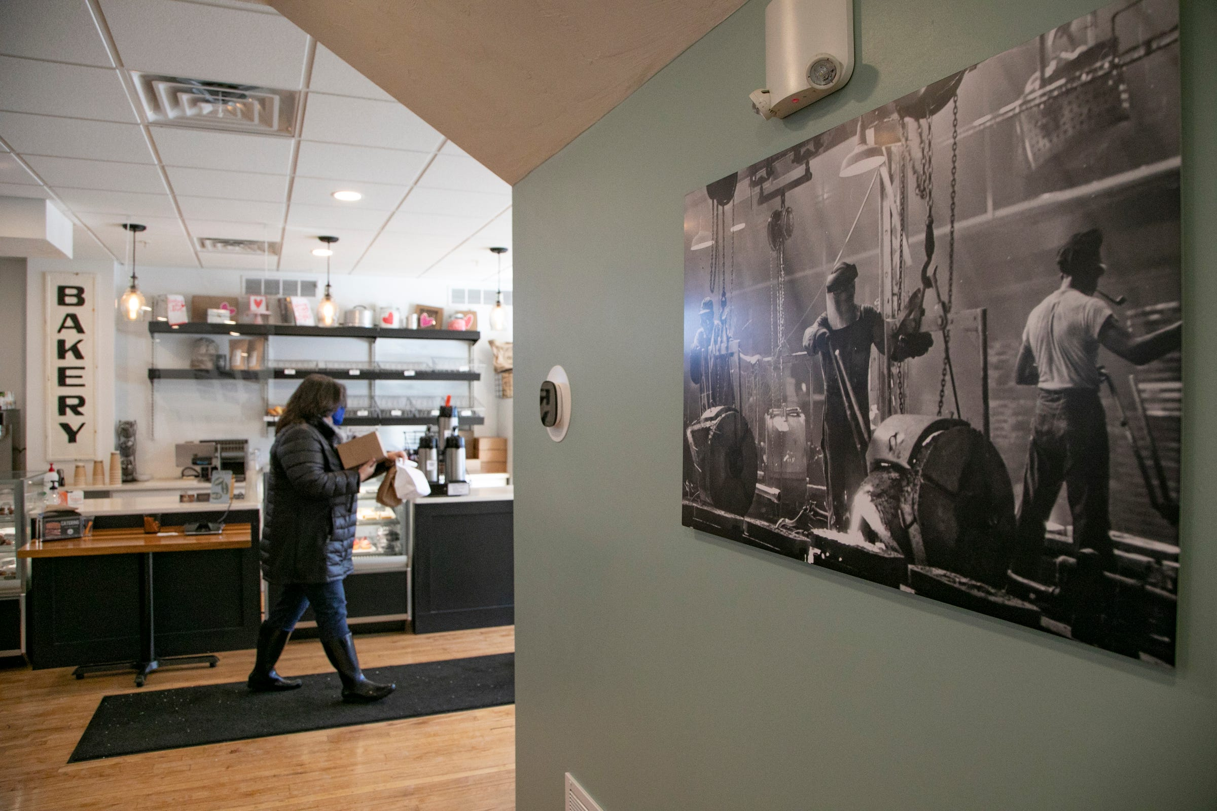 Historic photos of foundry workers in Albion hang on the walls of the Foundry Bakehouse and Deli in downtown Albion.