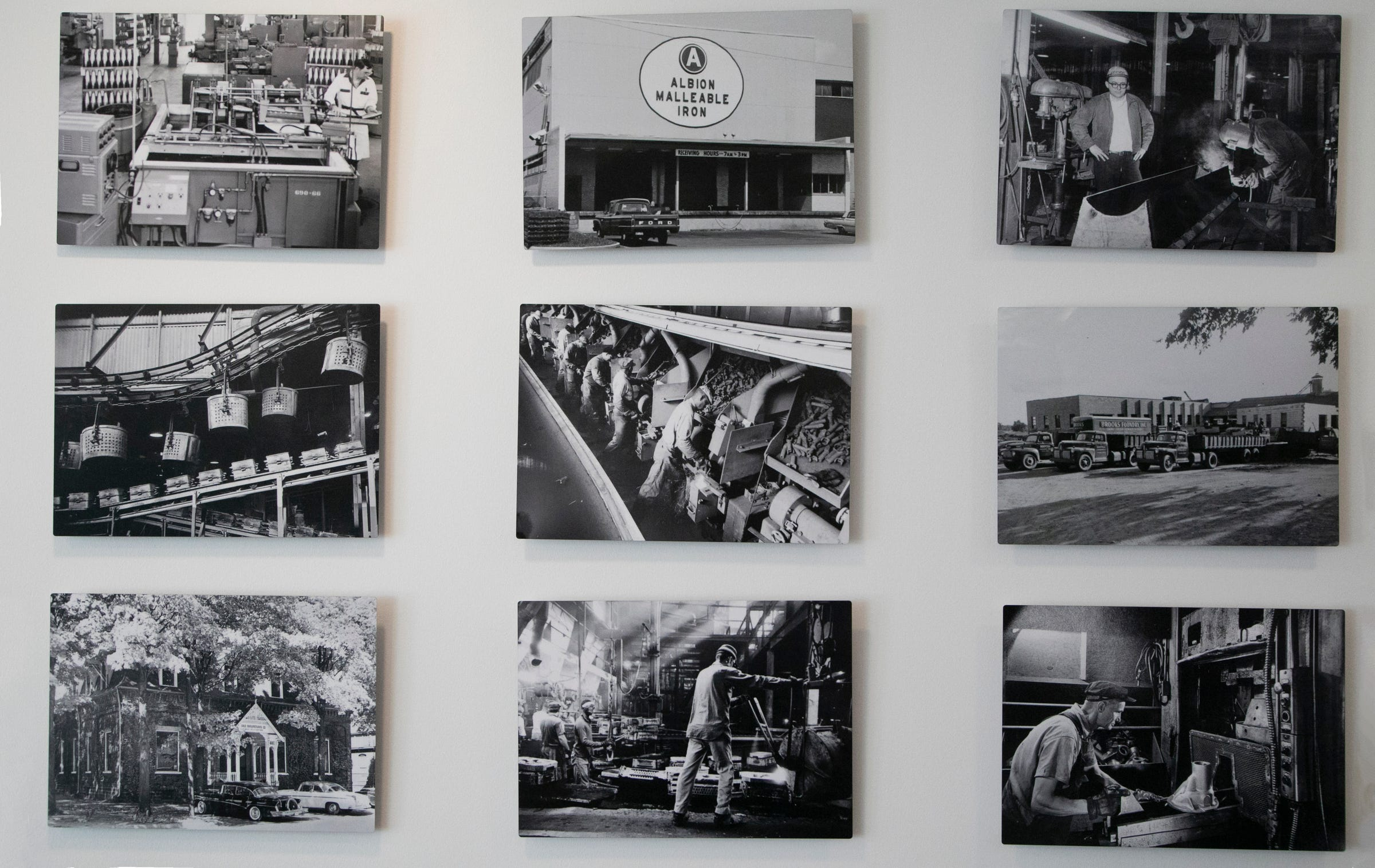 Historic photos of the foundry industry that was once the main occupation in Albion on Tuesday decorate the walls of the Foundry Bakehouse and Deli in downtown Albion.