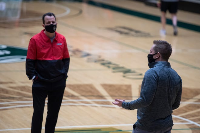 Colorado State basketball head coach Niko Medved speaks with New Mexico Lobos head coach Paul Weir after the game between the New Mexico Lobos and Colorado State Rams was cancelled due to COVID-19 at Moby Arena at Colorado State University in Fort Collins, Colo. on Tuesday, Feb. 9, 2021.