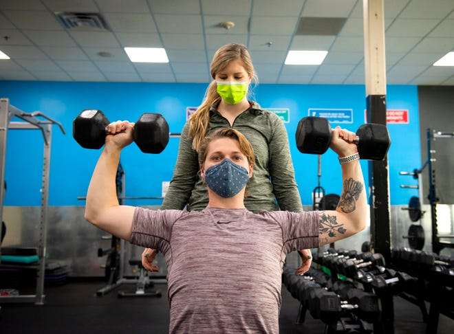 Natalie Ribble spots Eli Strom as he lifts weights at the Prisma Health Family YMCA in Simpsonville.