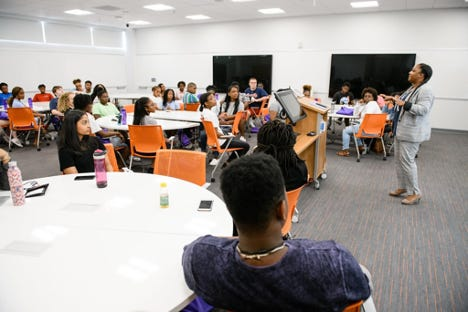 Shontavia Johnson (AVP in the Provost's Office) talks to a group of Clemson Career Workshop students during their summer program.