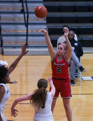 Anderson County's Sophie Smith (2) shot against Mercy defenders during their game at Mercy Academy on Feb. 9, 2021.  Anderson County won 79-58.