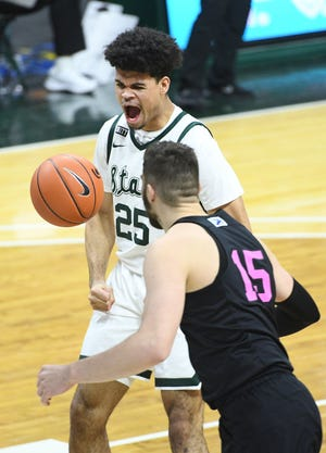 Feb 9, 2021; East Lansing, Michigan, USA; Michigan State Spartans forward Malik Hall (25) reacts during the second half against the Penn State Nittany Lions at Jack Breslin Student Events Center. Mandatory Credit: Tim Fuller-USA TODAY Sports