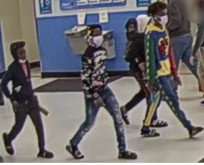 Montgomery authorities are searching for three suspects in connection with a fire inside an Atlanta Highway Walmart.