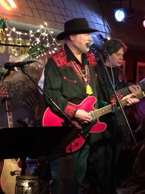 Les Kerr (seen performing at the Bluebird Cafe with bassist Roy Vogt) will lead the 30th annual Mardi Gras celebration at the Bluebird on February 16.