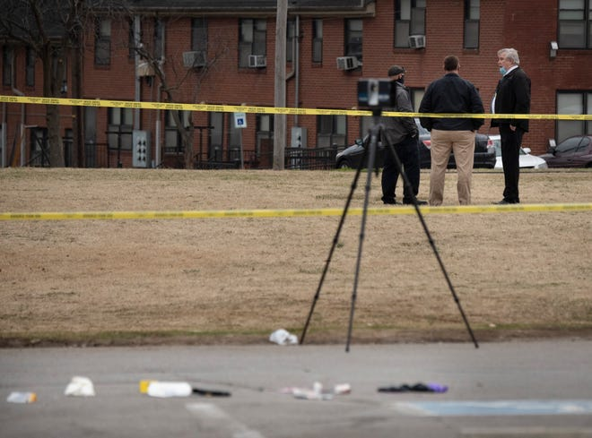 Metro police investigate where a man who ran from police officers in the JC Napier public housing complex accidentally shot himself along Claiborne St. Wednesday, Feb. 10, 2021 in Nashville, Tenn.