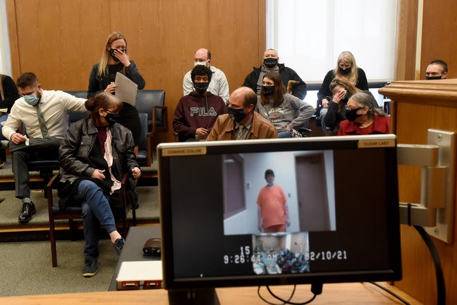 """Destiny Kemmerling is overcome with emotion and is comforted by Nick Fisher while addressing the court on Wednesday, Feb. 10, 2021. Destiny Kemmerling spoke of the affect the loss of her sister, 24-year-old Kayla Kemmerling, had on herself and her family, many of whom attended the hearing wearing """"#JusticeForKayla"""" masks. Since receiving life-changing call from her other sister, Destiny Kemmerling wrote how she has suffered from anxiety on a daily basis as she grieves her sister's loss and pictures her final moments."""