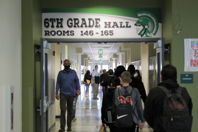 Tibbetts Middle School sixth grade students walk to their second period classes on Tuesday, Feb. 9, 2021. It was the first day for hybrid learning for Farmington middle and high school students.