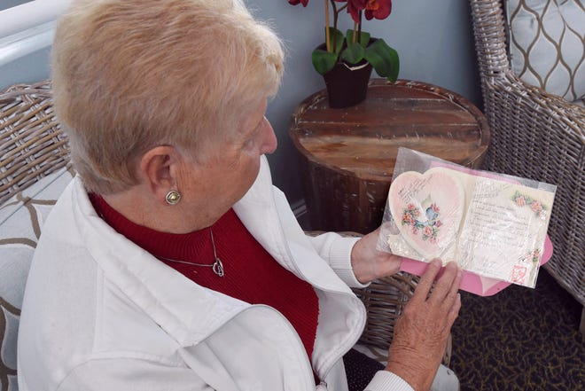 Judy Neisch holds the Valentine's Day card that has been exchanged among her family members for the past 80 years. It was first passed between Neisch's mother and aunt beginning in 1941. When the two women died within months of each other, Neisch and her cousin, Arizona resident Sandy Mettille, took up the family tradition.