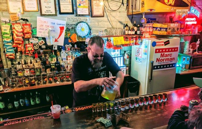 Chuck Marthaler tends bar at the Palo Verde Lounge in Tempe, Arizona.