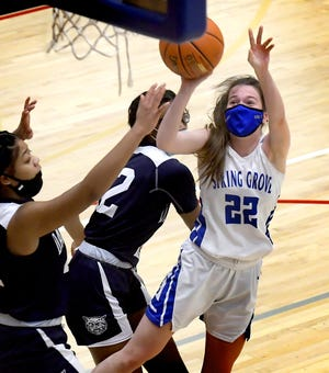 Spring Grove's Ella Kale gets off a shot with pressure from  Dallastown's Bria Beverly, left, and Trishelle Guy during action at Spring Grove Tuesday, Feb. 9, 2021. Spring Grove won 55-42. Kale scored her 1,000th career point during the game. Bill Kalina photo