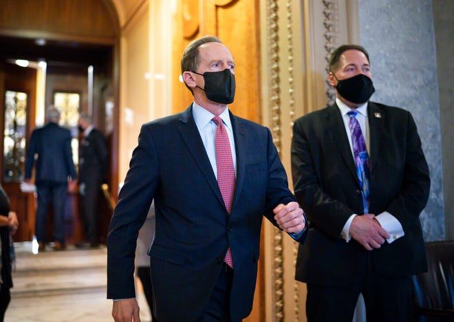Sen. Pat Toomey, R-Pa., leaves the chamber after taking an oath and voting on how to proceed on the impeachment against former President Donald Trump, at the Capitol in Washington, Tuesday, Jan. 26, 2021. (AP Photo/J. Scott Applewhite)