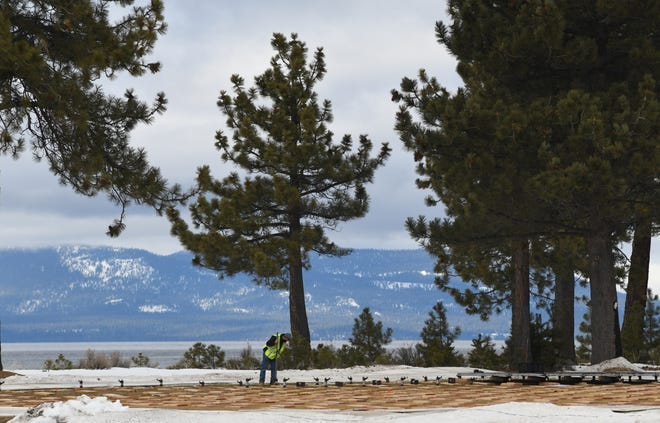 A crew works on building an ice rink on the Edgewood Tahoe golf course on Feb. 9, 2021. Two regular-season outdoor games to be played at Edgewood Tahoe Resort.